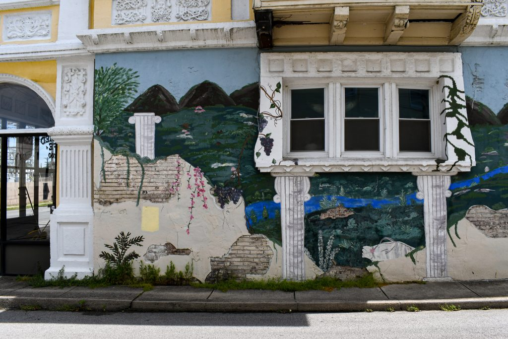 Old World Building with Pillars Mural on Limestone