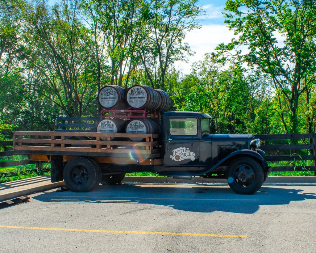 Jeptha Creed Vintage Ford Truck with Bourbon Barrels in Bed
