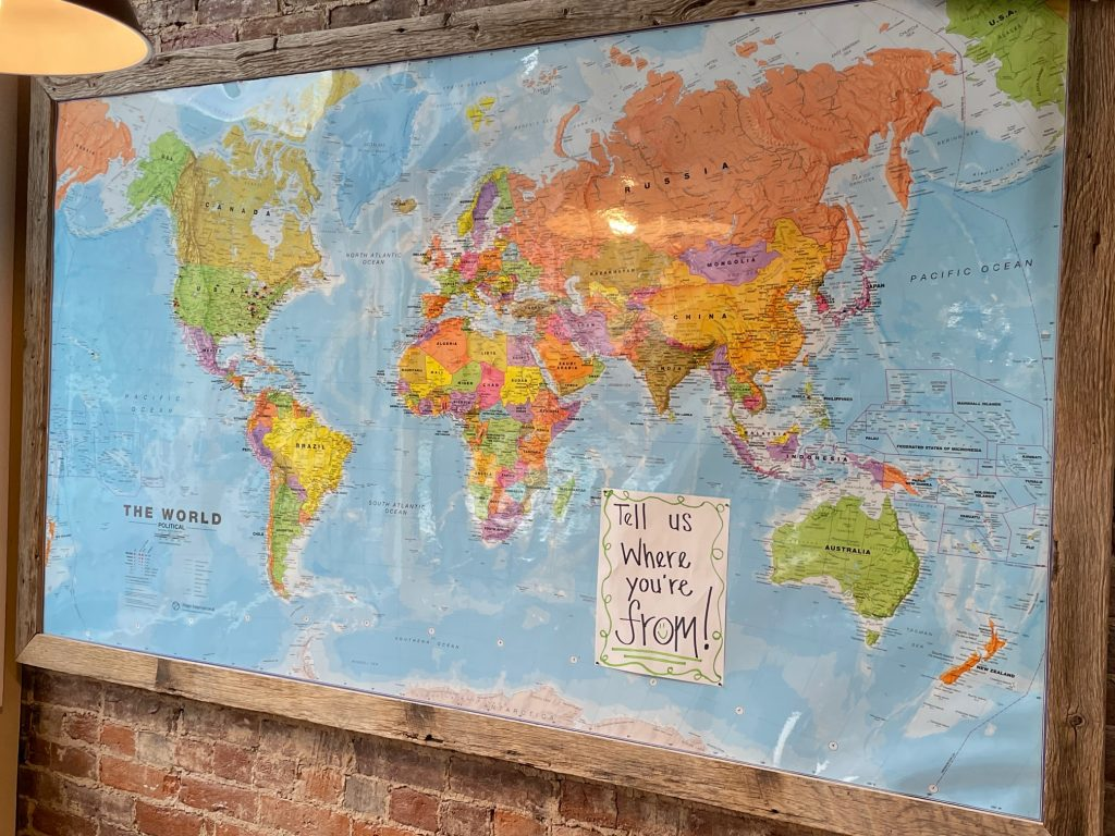 Where are you from map at the entrance to The Pie - Brick Oven Pizza
